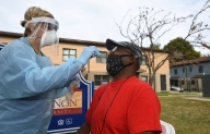 The Latest: Arizona officials urge keeping mask mandate