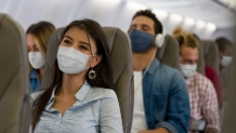 Is it safe to fly during COVID-19 pandemic? Two reports at odds